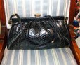 black patent snake purse