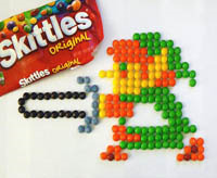 8-bit video game character made with skittles candy