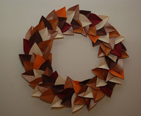 autumn craft idea featuring a paper leaf wreath