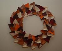 autumn craft idea featuring a paper leaf wreath