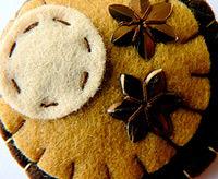 Autumn craft idea featuring fall themed pincushion