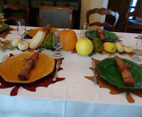 Thanksgiving tablescape idea using felt leaves as placemats