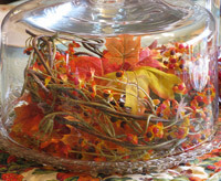 Thanksgiving centerpiece idea on using a cake cover or wine glass as a cloche