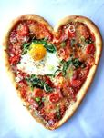Heart-shaped pizza with fried egg