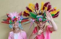 two girls wearing elaborate homemade head piece masks