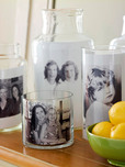 glass canisters lined with photos to create 3-D photo collage.