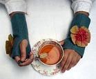 knit wrist cozy from craft fair
