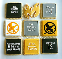 food coloring painted mocking jay cookies and royal icing cookies