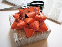 reused paper repurposed as wrapping paper and bow.