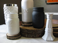 mason jars and other jars spray painted with matte paint