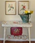 wicker table with pictures of rose under glass