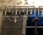 floral wallpaper with iron gate hanging