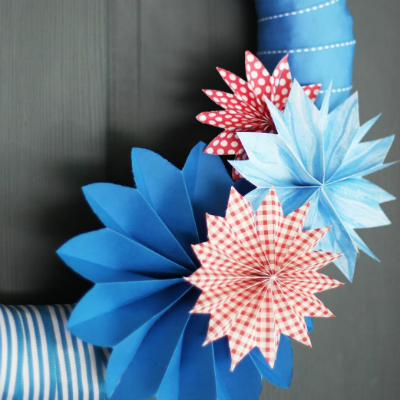 A ribbon and paper fireworks wreath