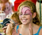 A young girl getting her face painted at the Personality Festival