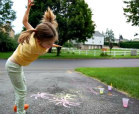 A little girl creating fireworks with chalk paint