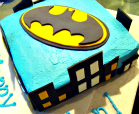 A cake featuring the bat symbol and Gotham