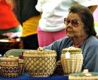 A basketmaker at the Native American Festival and Basketmakers Market