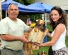 Fletcher Farm Artists displaying their carving
