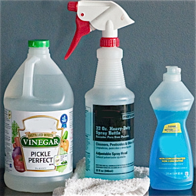 mixing white vinegar with detergent for DIY all-purpose cleaner