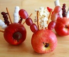 Thanksgiving turkey made from an apple and marshmallows on toothpicks.