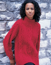Woman in a long, red, cabled sweater.