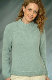 Woman in a light blue sweater.