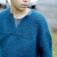 Young boy wearing a blue sweater