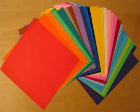 Colored paper fanned out on a table.