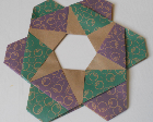A paper wreath with purple and green coloring.