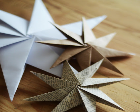 Sunburst shaped ornaments made from paper