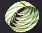 Paper ornament made from strips of paper circles inside one another.