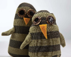 Two owls made from striped, brown socks.