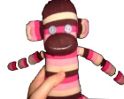 Sock monkey made from striped pink socks.