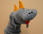Dinosaur hand puppet made from a grey sock.