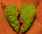 A keychain shaped like a brain, painted green and cut into two pieces.