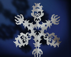Paper snowflake cut with the shapes of zombie faces.