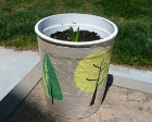 A planter made from a yogurt container coated in paper mache.
