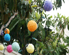 Ball-shaped party lights made from paper mache.