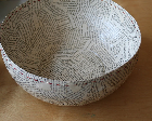 Bowl made from paper mache and decorated with old book pages.
