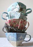Stack of teacups made from paper mache.