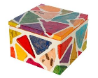 Box made of paper mache and decorated with colored triangles.