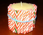 6 candy cane crafts for kids craftfoxes for Candy cane holder candle centerpiece