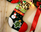 Homemade stocking with a snowman and Christmas tree pattern.