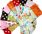 A lot of colorfully patterned homemade stockings arranged in a circle.