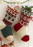 Homemade stockings made with red, green, and white thread.