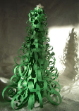 A Christmas tree centerpiece made from green, curled paper.