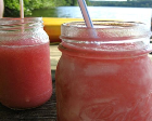 A pink drink in jars