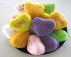 Multi-colored conversation hearts made from felt.