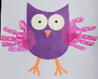 Owl made from purple paper with handprints as the wings.