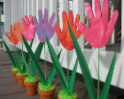 Colorful flowers made from handprints